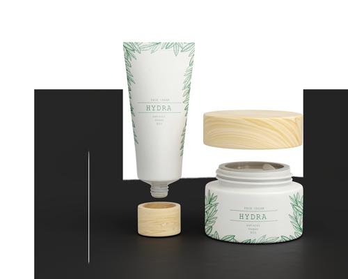 Image d'un tube cosmétique et un couvercle.
